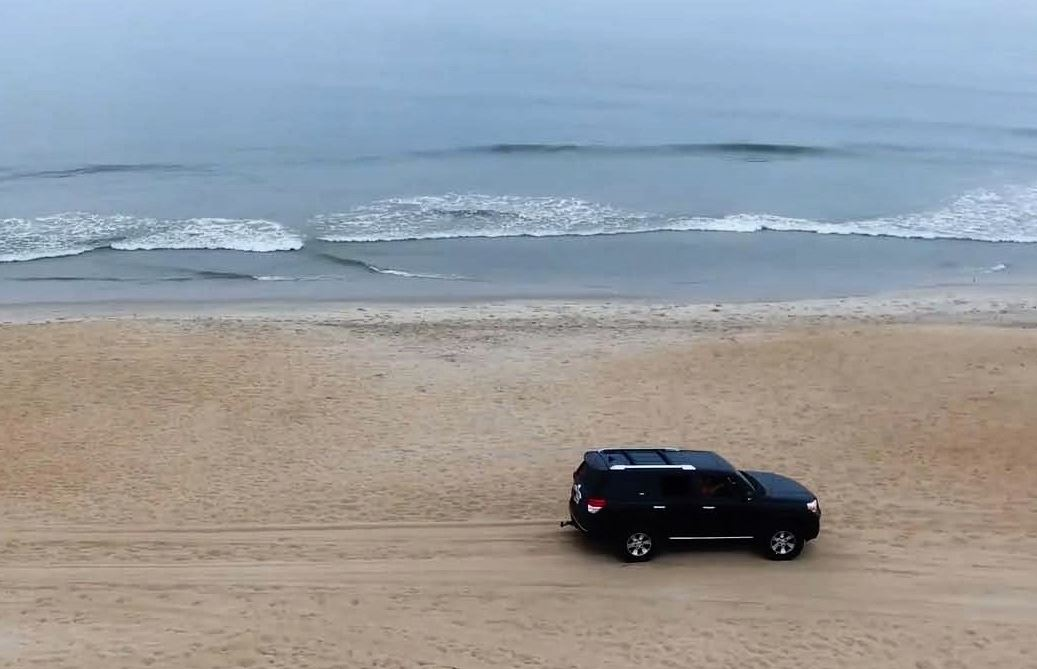 Vehicle driving on the beach in KDH